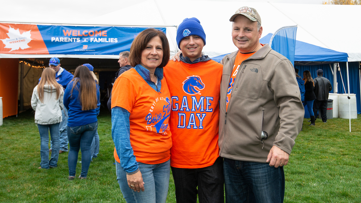 Photo of three family members together during the Boise State Parent and Family Weekend in 2018.