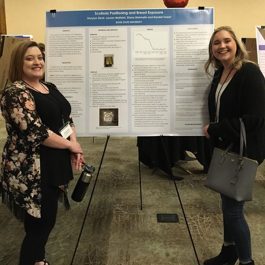Researchers presenting posters showcasing their work