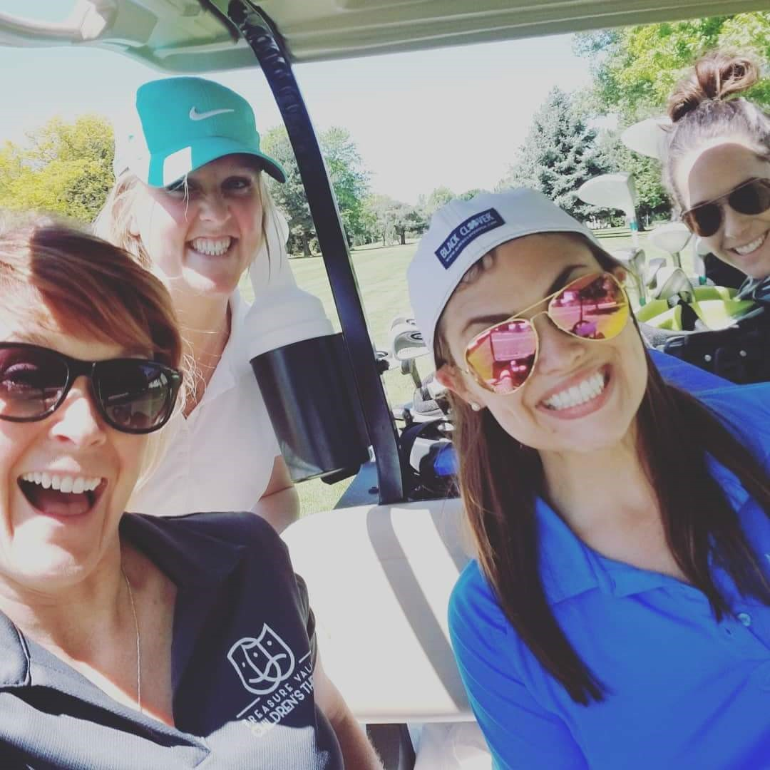 Golfers in golf cart