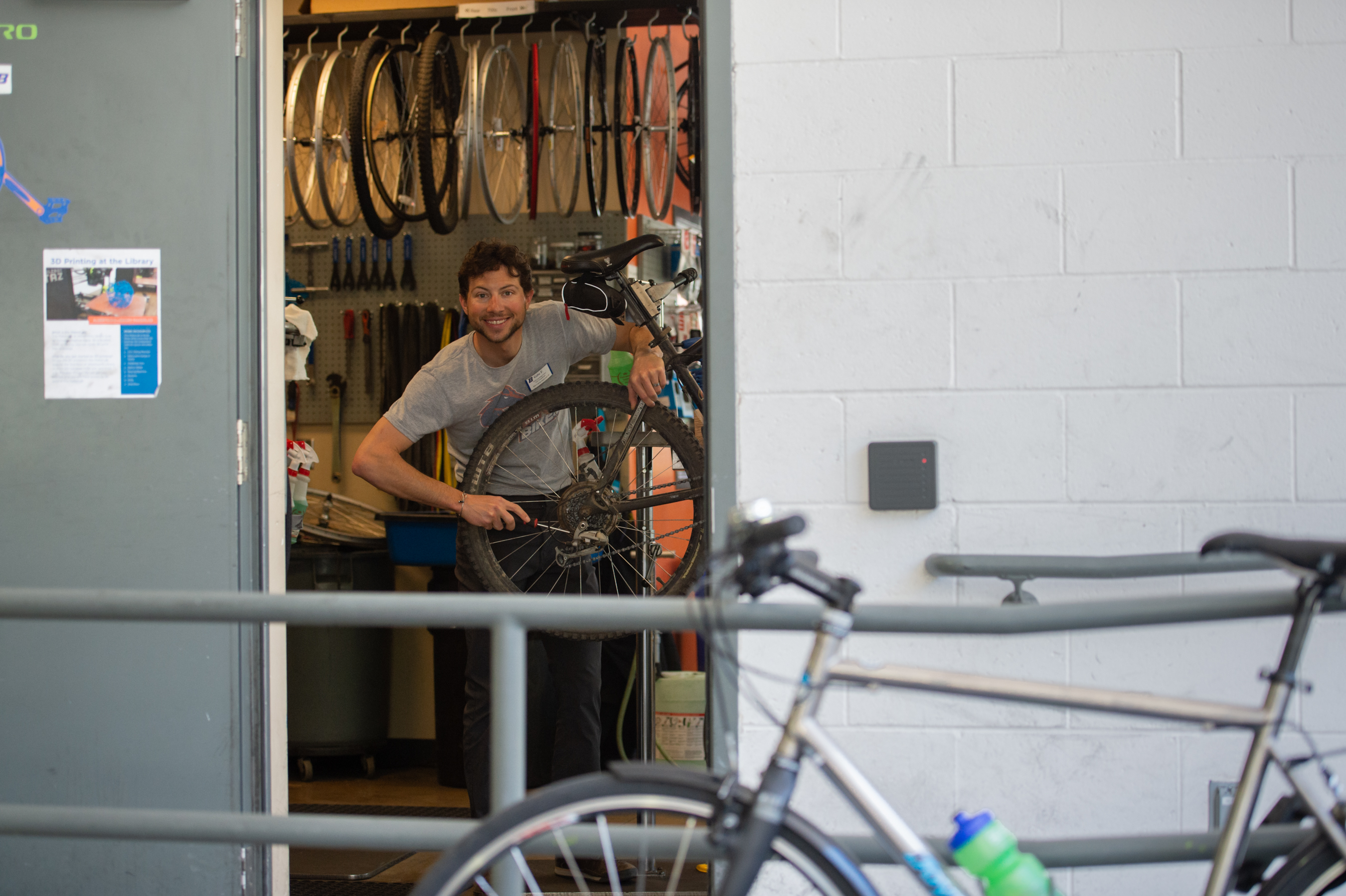 Gabe Finkelstein and the Cycle Learning Center are keeping bikes rolling at a safe distance. Photo, Patrick Sweeney.