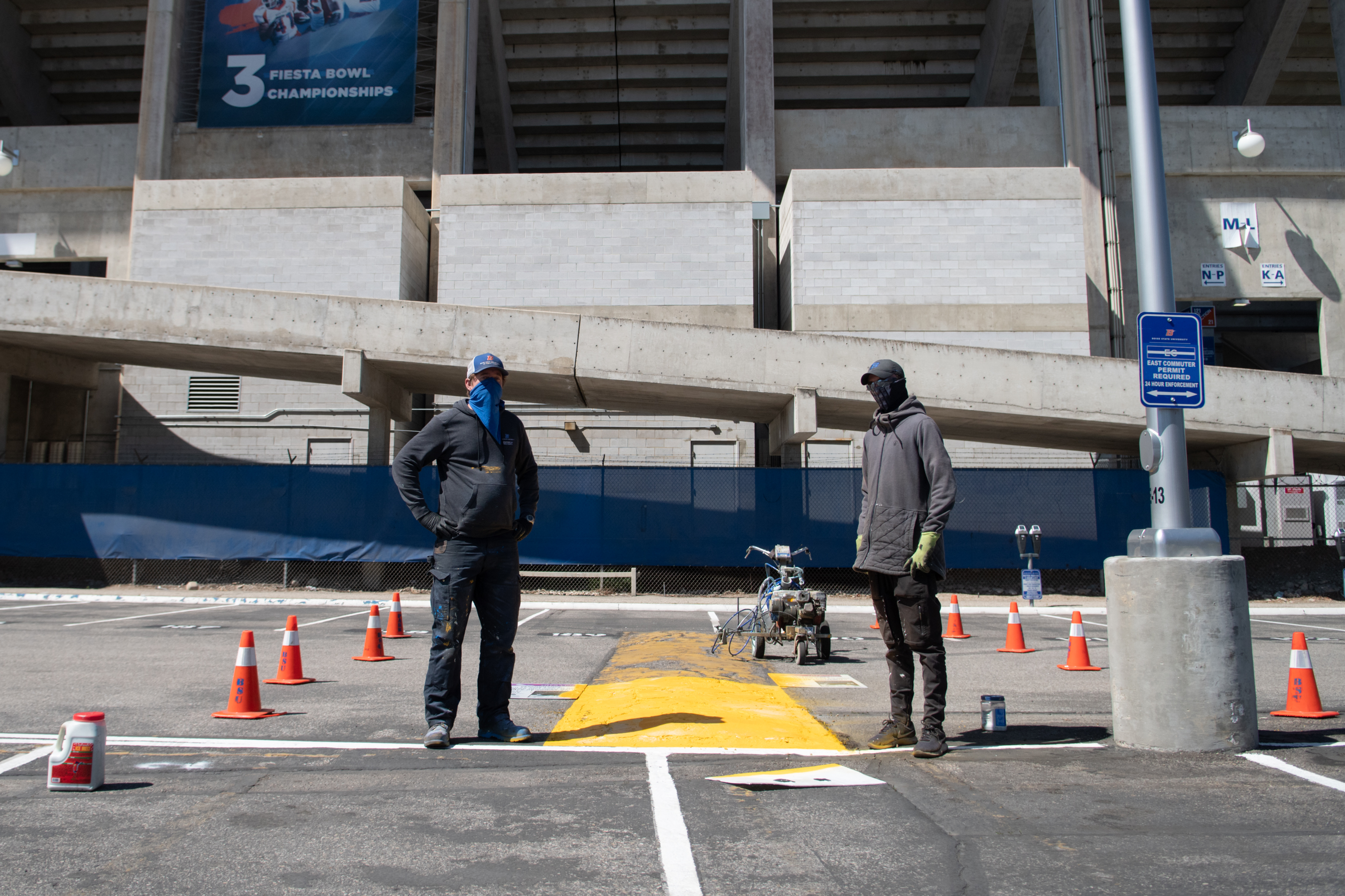 Scott Bridges, left, and Zack Cuffel work to repaint the empty West Stadium lot. Bridges is also a songwriter and Cuffel is a Boise State student. Photo, Patrick Sweeney.