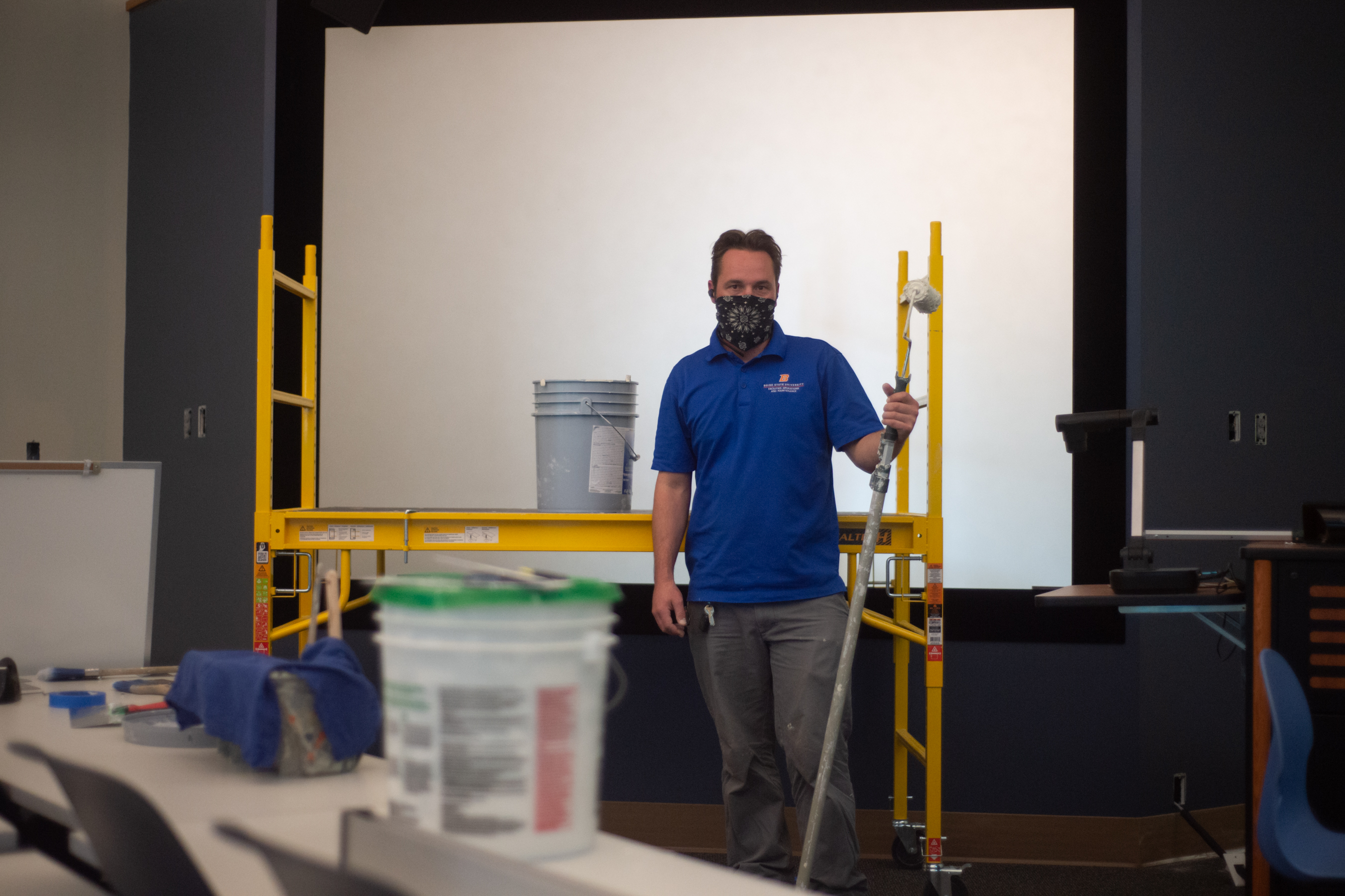 Jason Carlton is working on a painting project in the Interactive Learning Center, where the team has been busy painting all of the building's classrooms and hallways. Photo, Patrick Sweeney.