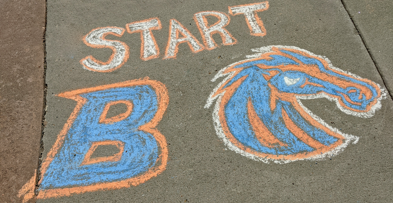 Chalk Drawing race start line with the B logo and Bronco Head