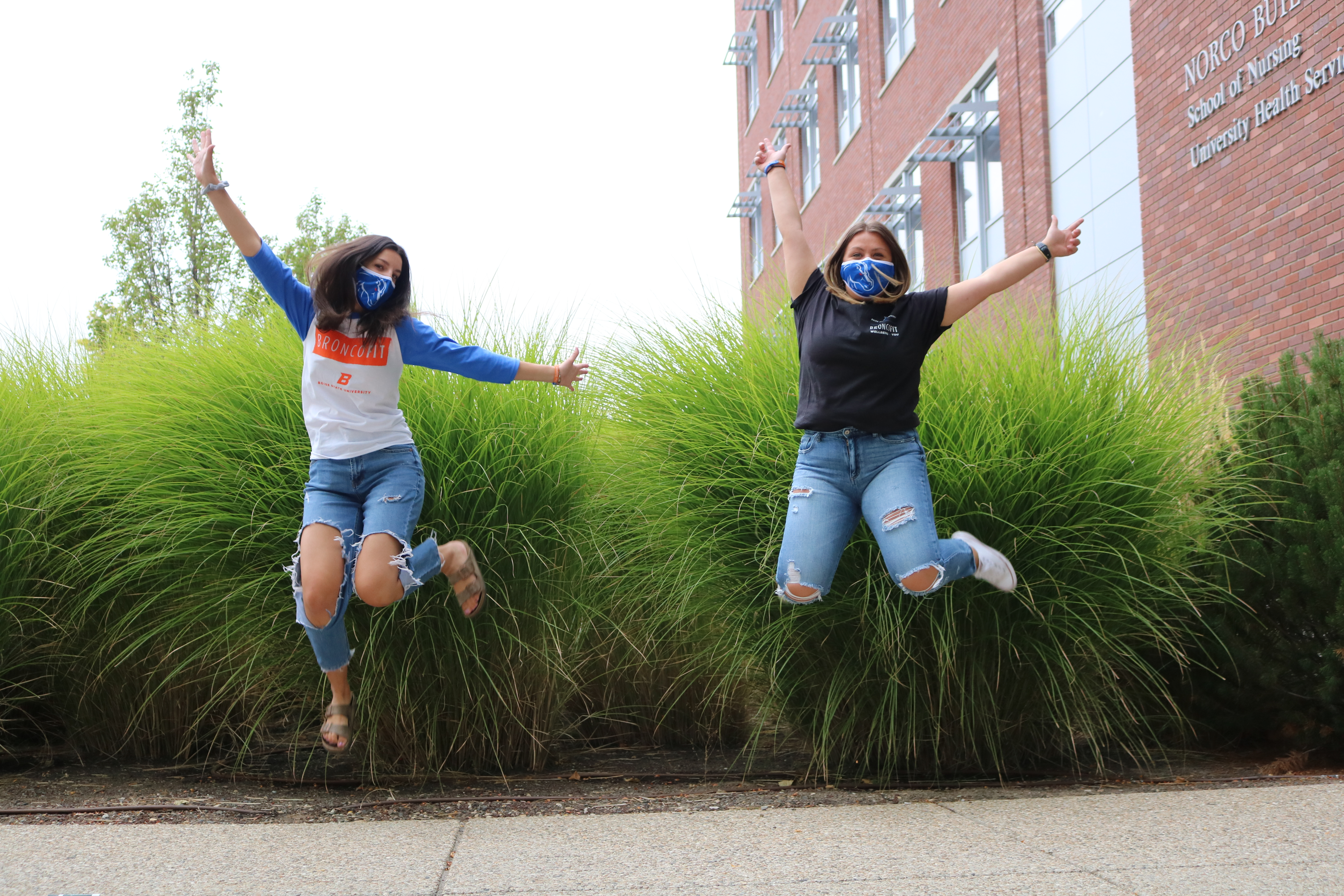 Two Boise State students jumping in masks
