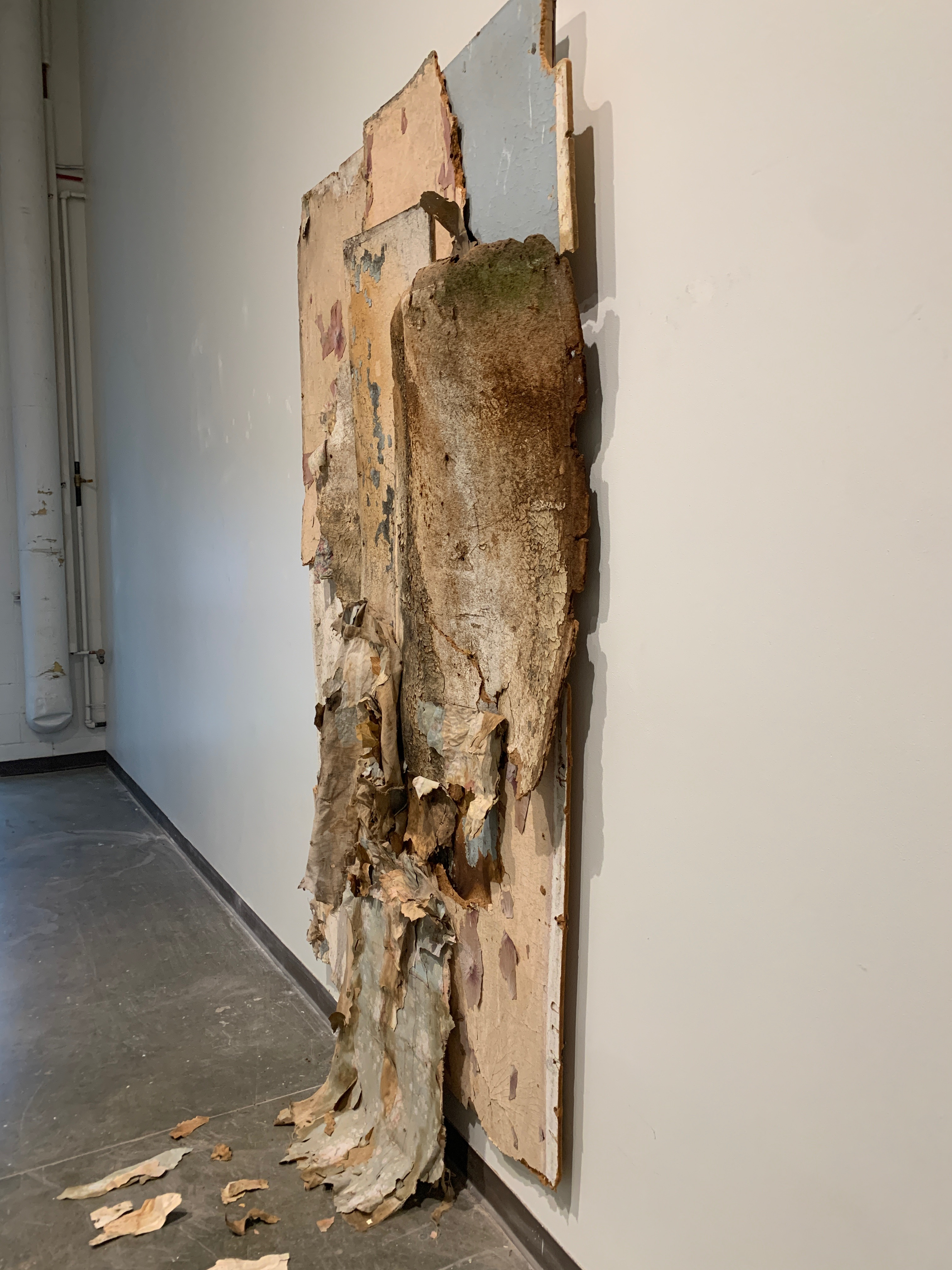 What Remains sculpture installed on the gallery wall, right view.
