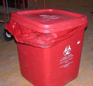 photo shows an improperly secured waste container