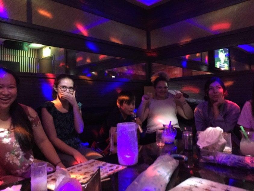 group doing karaoke