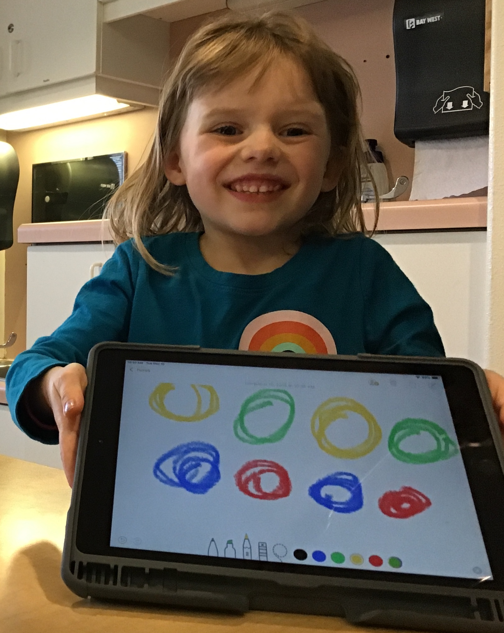 Girl showing pattern created on iPad
