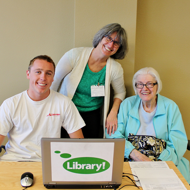 student tax helper and Kathy Hurly and a senior client