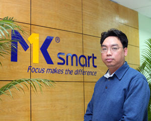 Khang in front of MK sign
