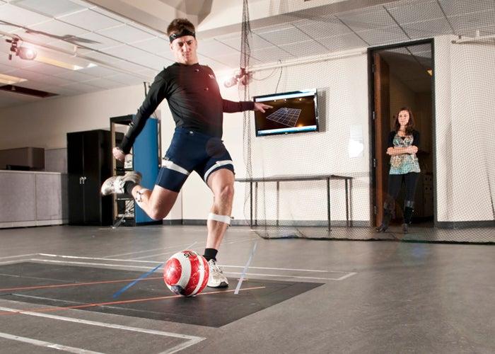 subject kicking ball