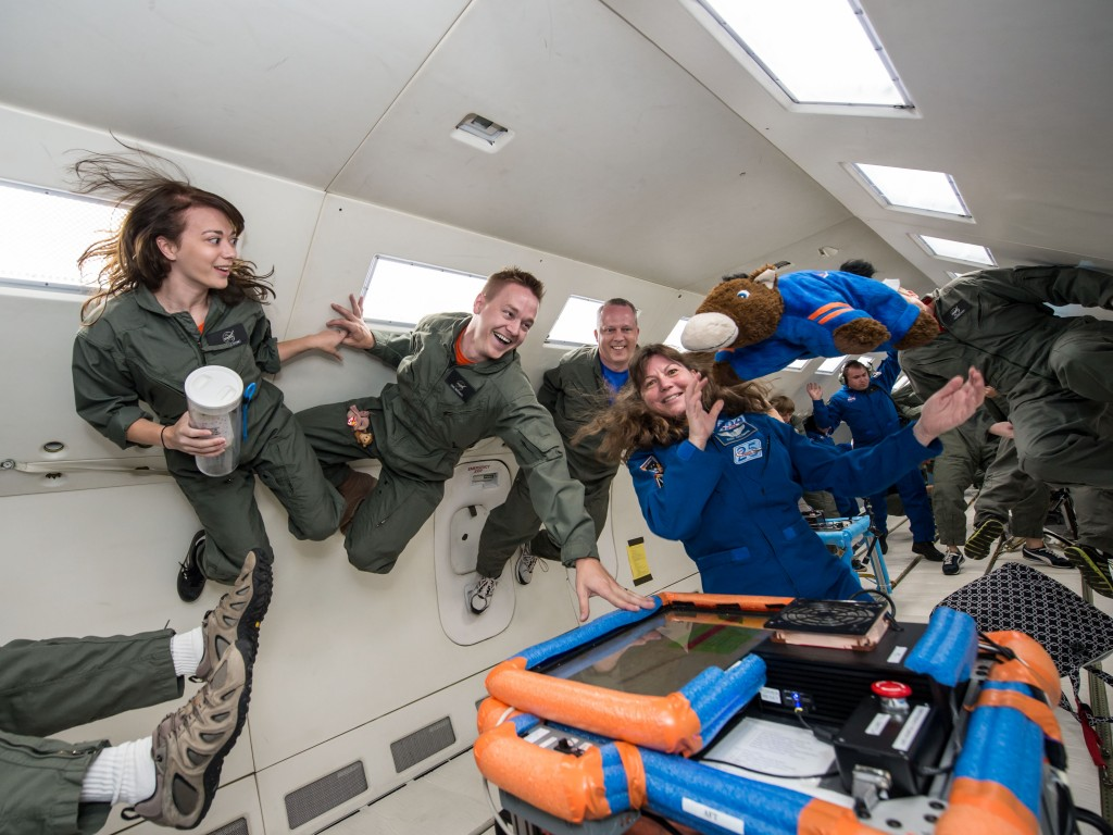 Students floating in NASA's weightlessness simulation plane