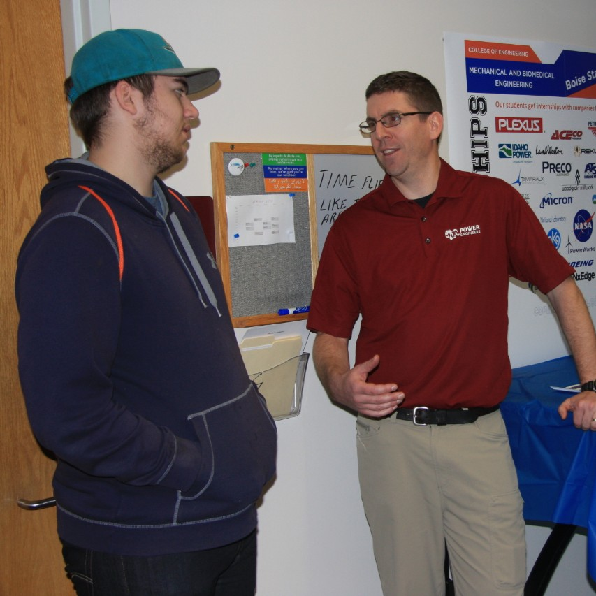 IAB member Tony Clark speaks with visitors at Bronco Day
