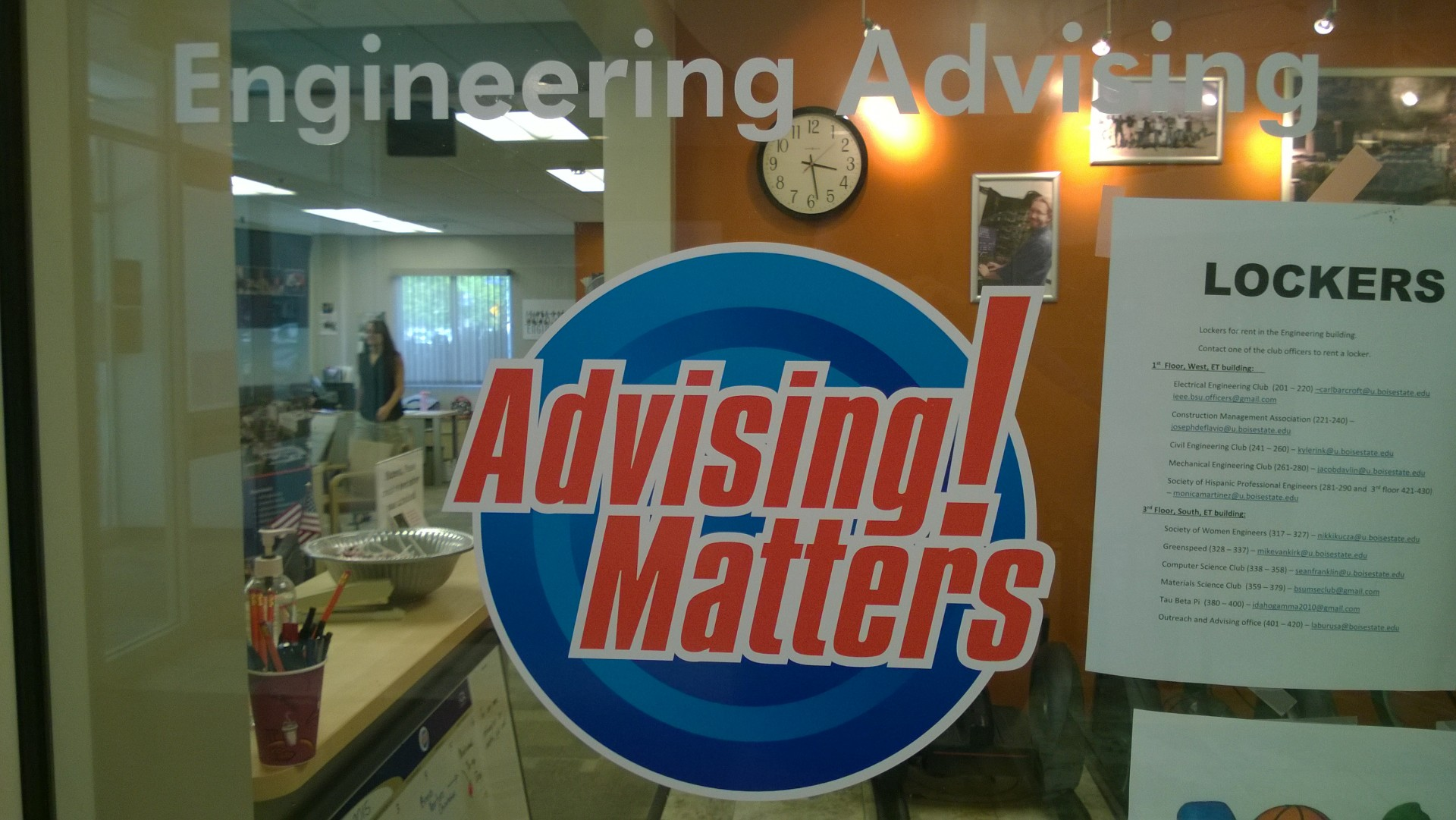 """glass window of COEN Advising office with 'Engineering Matters!"""" decal"""