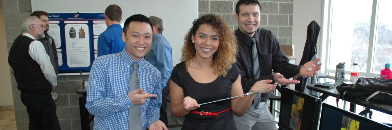 diverse group of students showing projects at a showcase