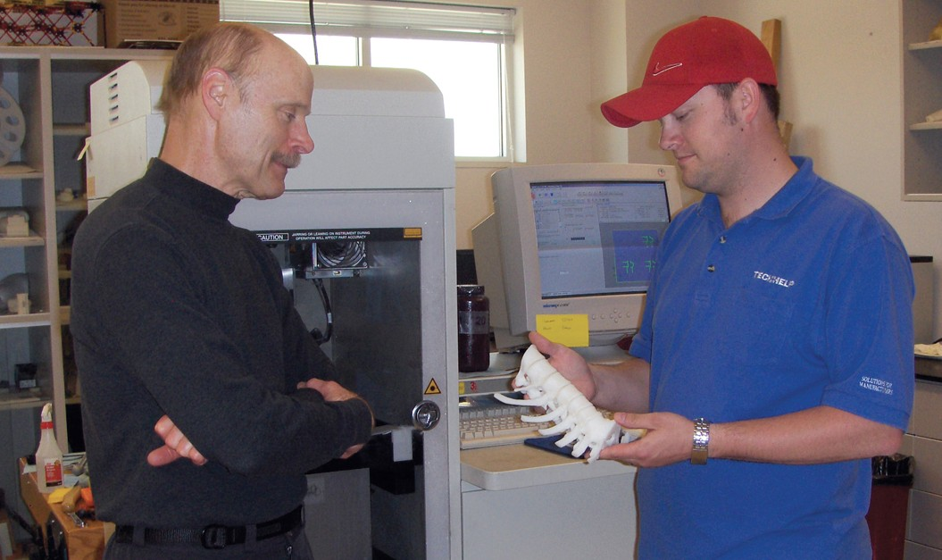 instructor and student with 3D printed spine section