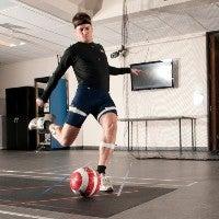 test subject kicking soccer ball