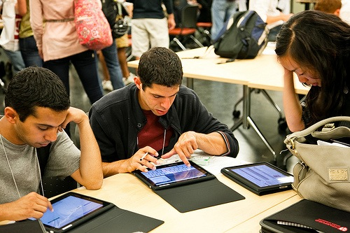 students working on tablet computers