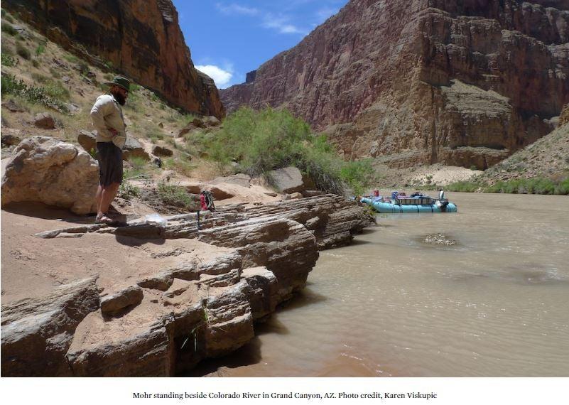 Mohr standing beside Colorado River in Grand Canyon, AZ. Photo credit, Karen Viskupic
