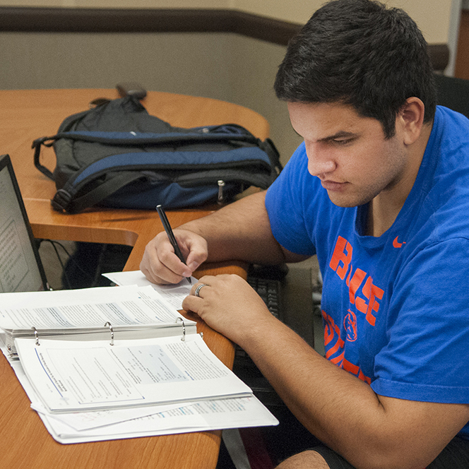 Student studying at a desk