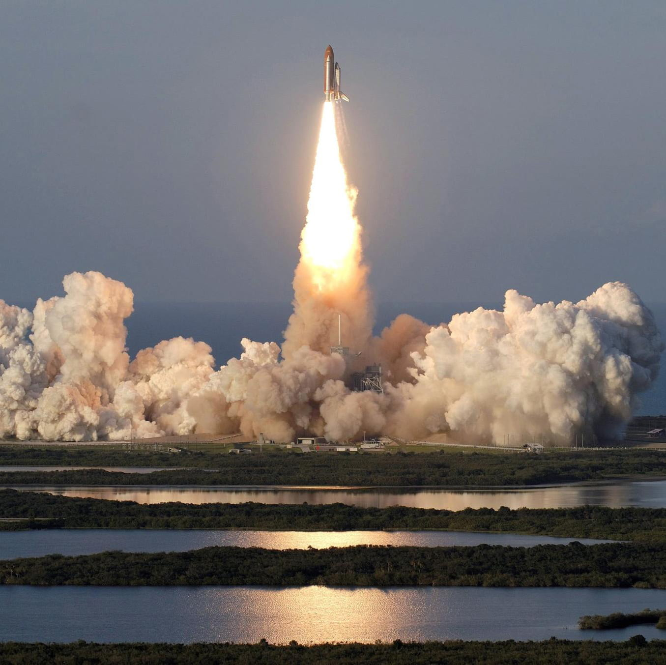 Space shuttle initial launch from pad