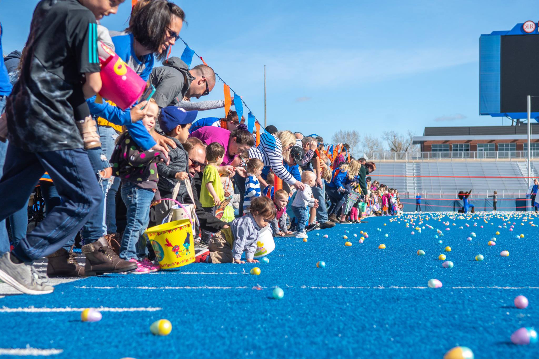 Boise State alumni and friends participating in the Easter Egg Hunt on The Blue