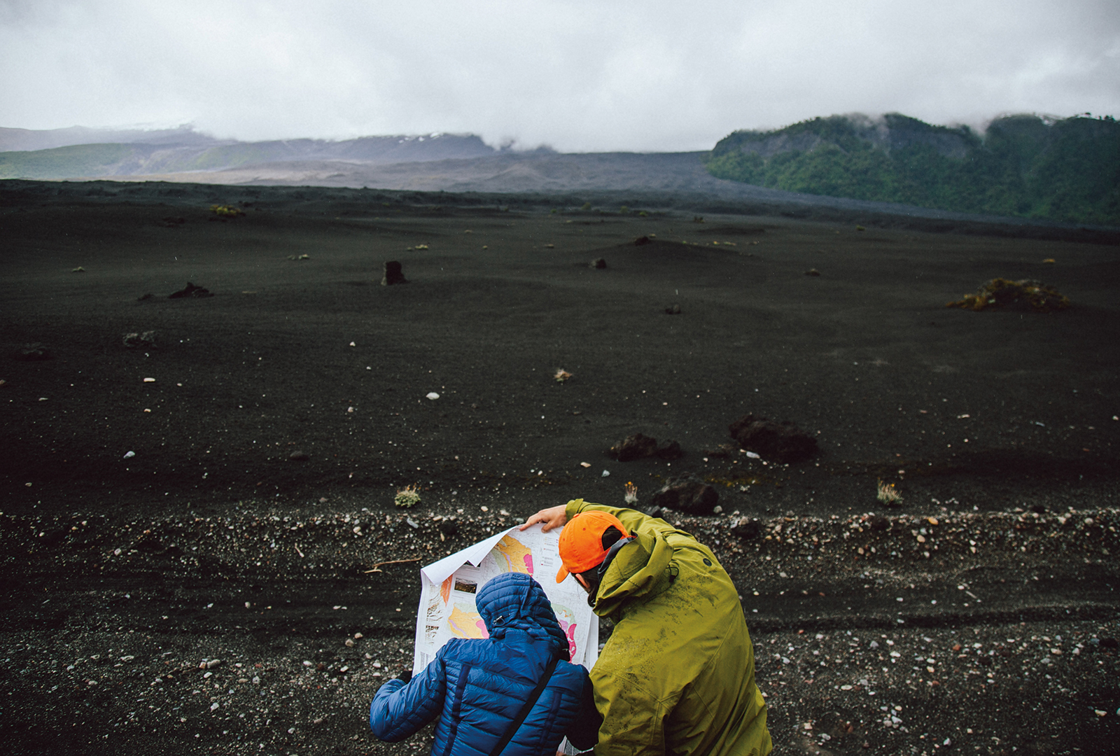 Dr. Brittany Brand & Aaron Marshall studying topographical maps at Llaima Volcano, Chile.