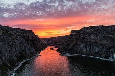 sun setting on river