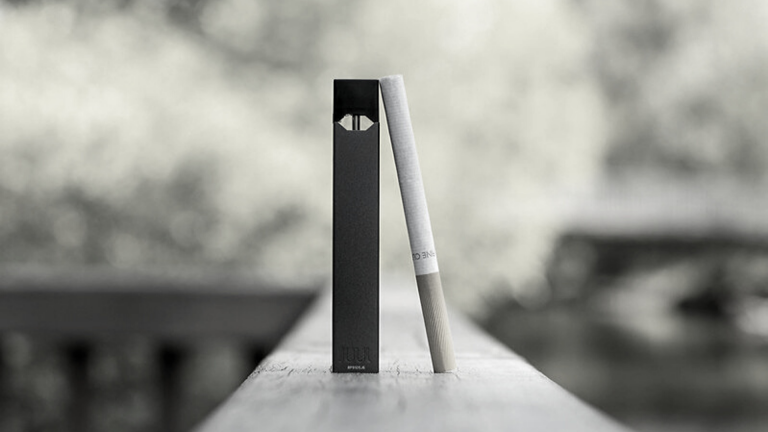 Photo of vaping pen and cigarette