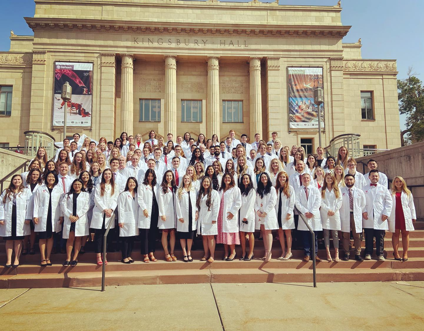 A group photo of University of Utah medical students standing in lab coats