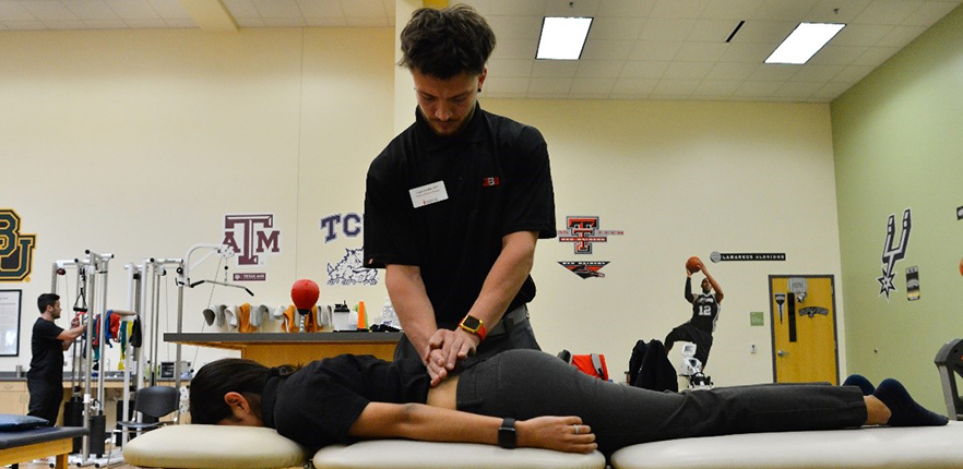 Physical Therapy student massaging a person's lower back