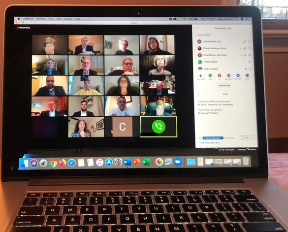 A photo of a Zoom meeting on a laptop