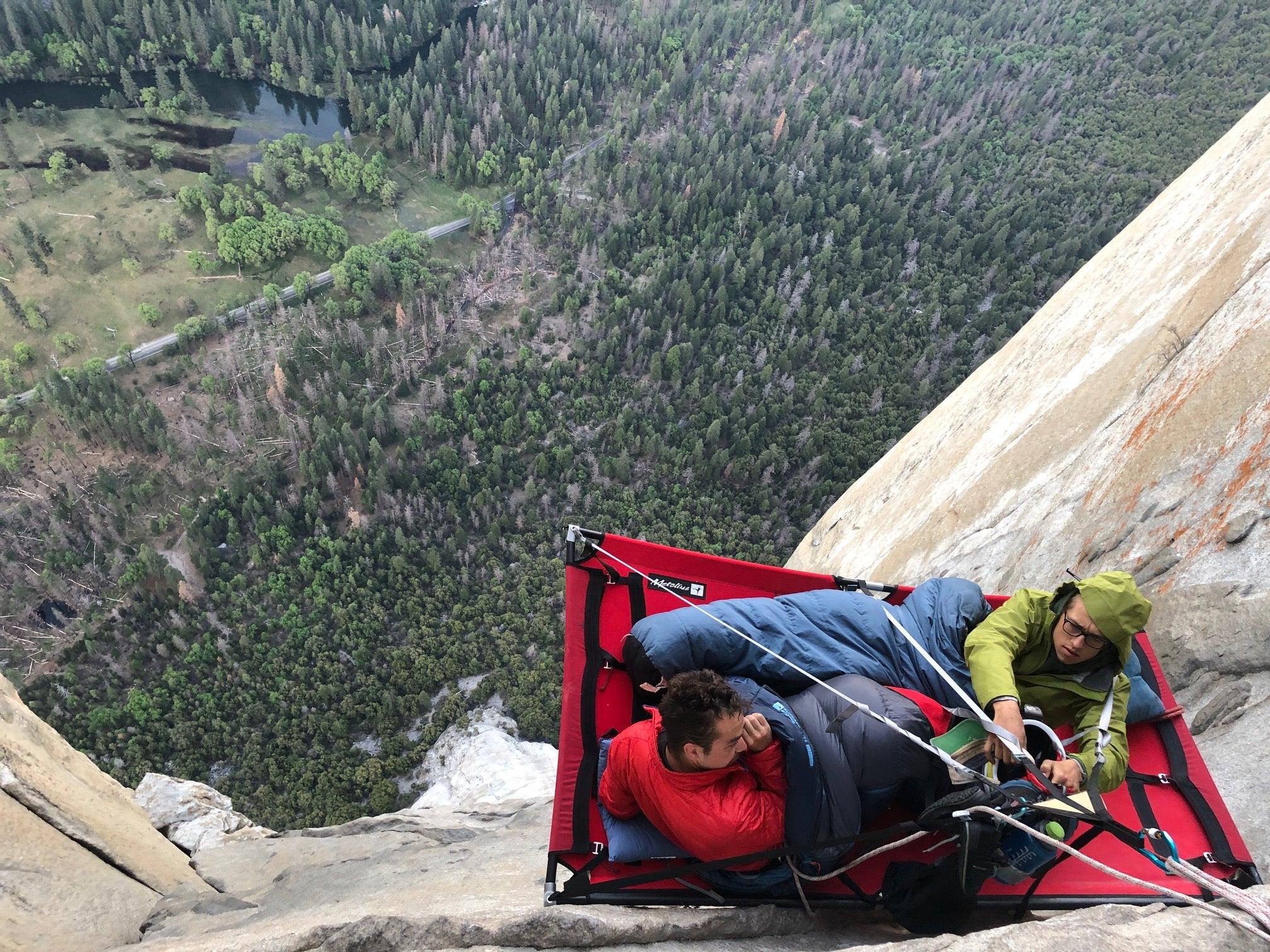 view of rock wall with Matt Clark on a sleeping/hanging platform