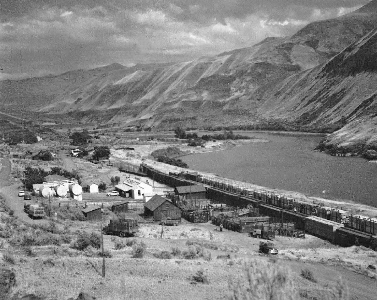 town next to river and mountains, black and white photo