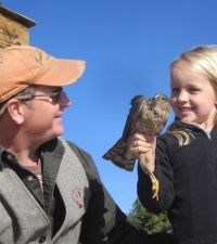 Greg with his daughter looking at a Cooper's Hawk