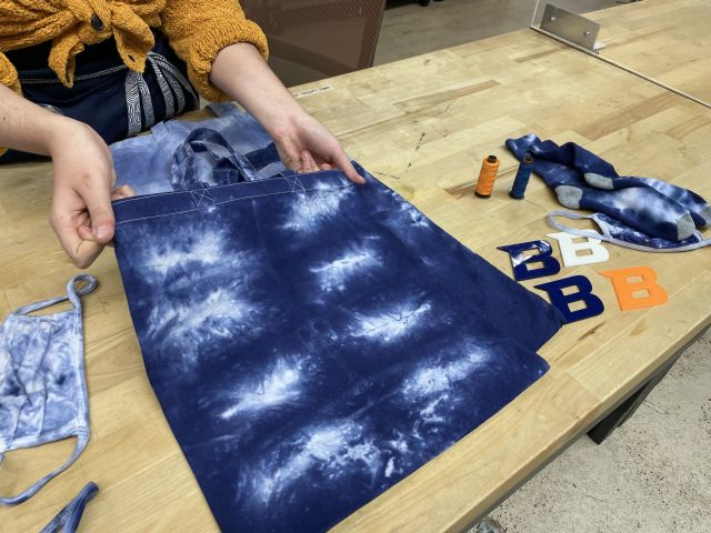 Color photo of a cloth bag that's been tie dyed white and blue