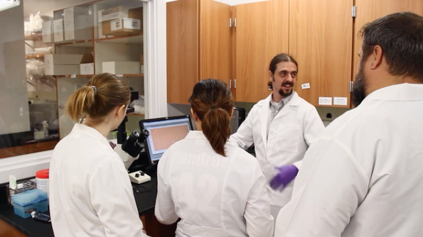 Gunes Uzer with students in his lab.