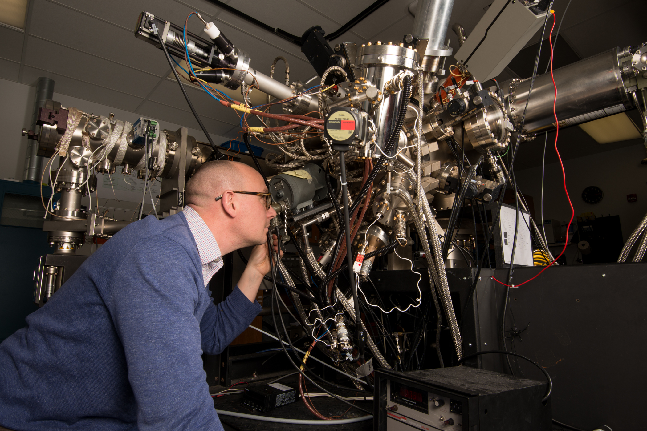 Simmonds looking closely at Molecular Beam Epitaxy device