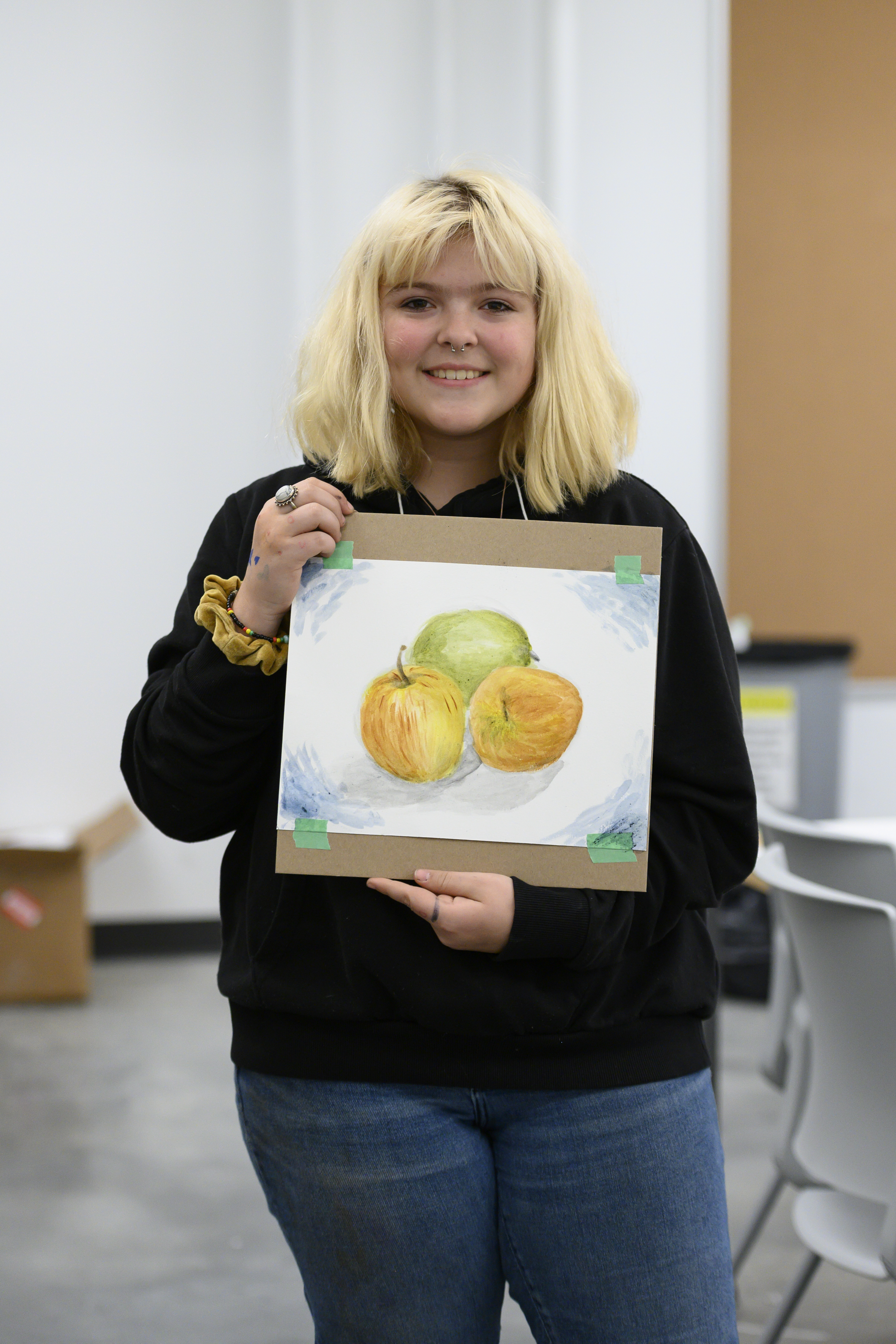 Participant shares painting of apples