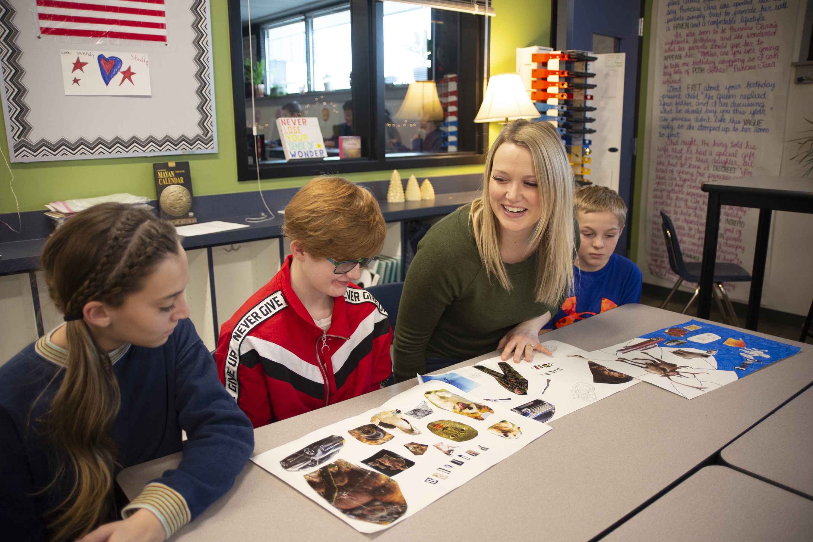 A teacher working with her students