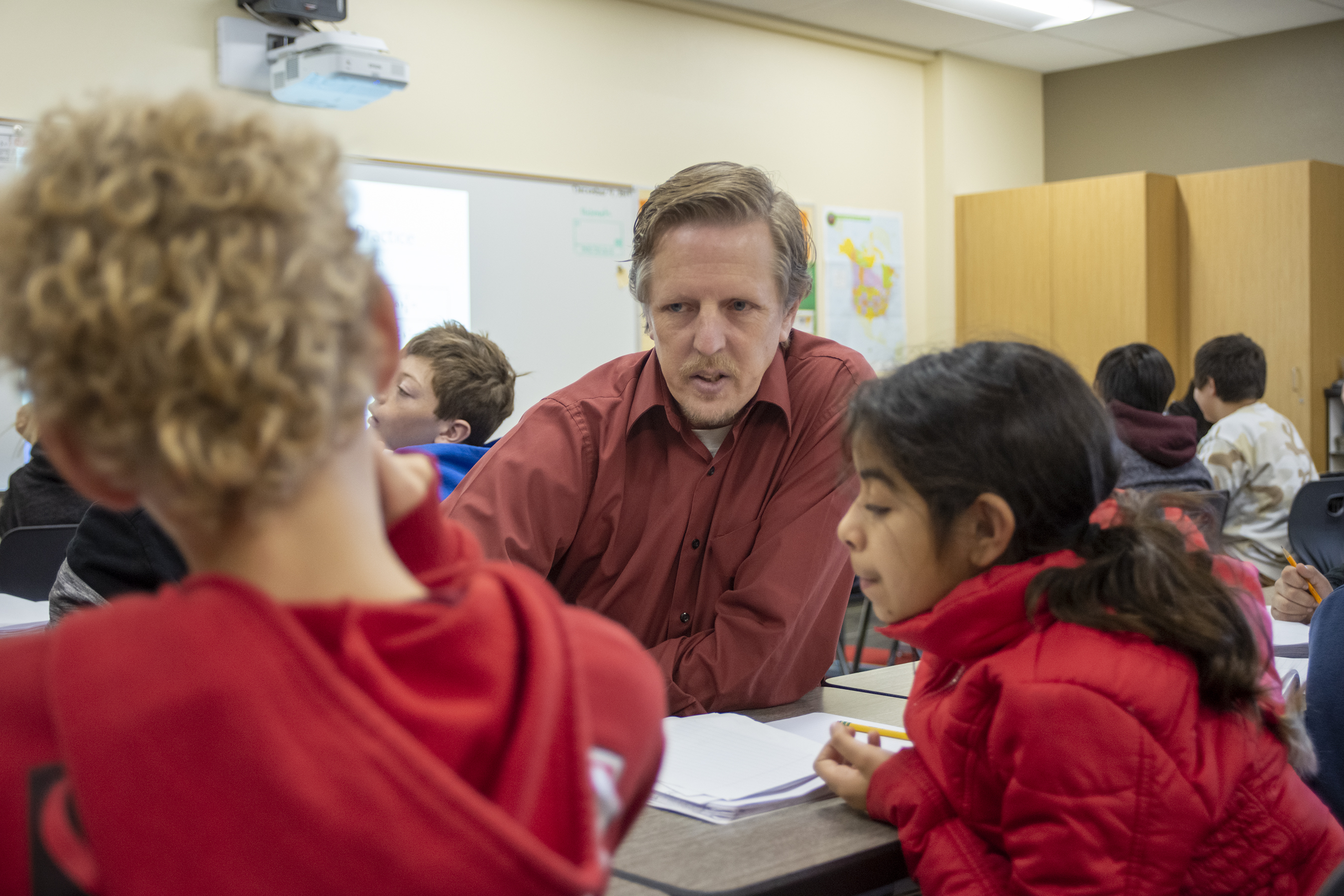 A teacher works with his students