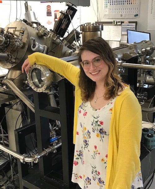 Katie standing by MBE machine