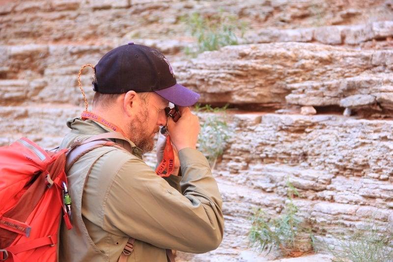 Professor Schmitz uses handheld device to inspect stone sample
