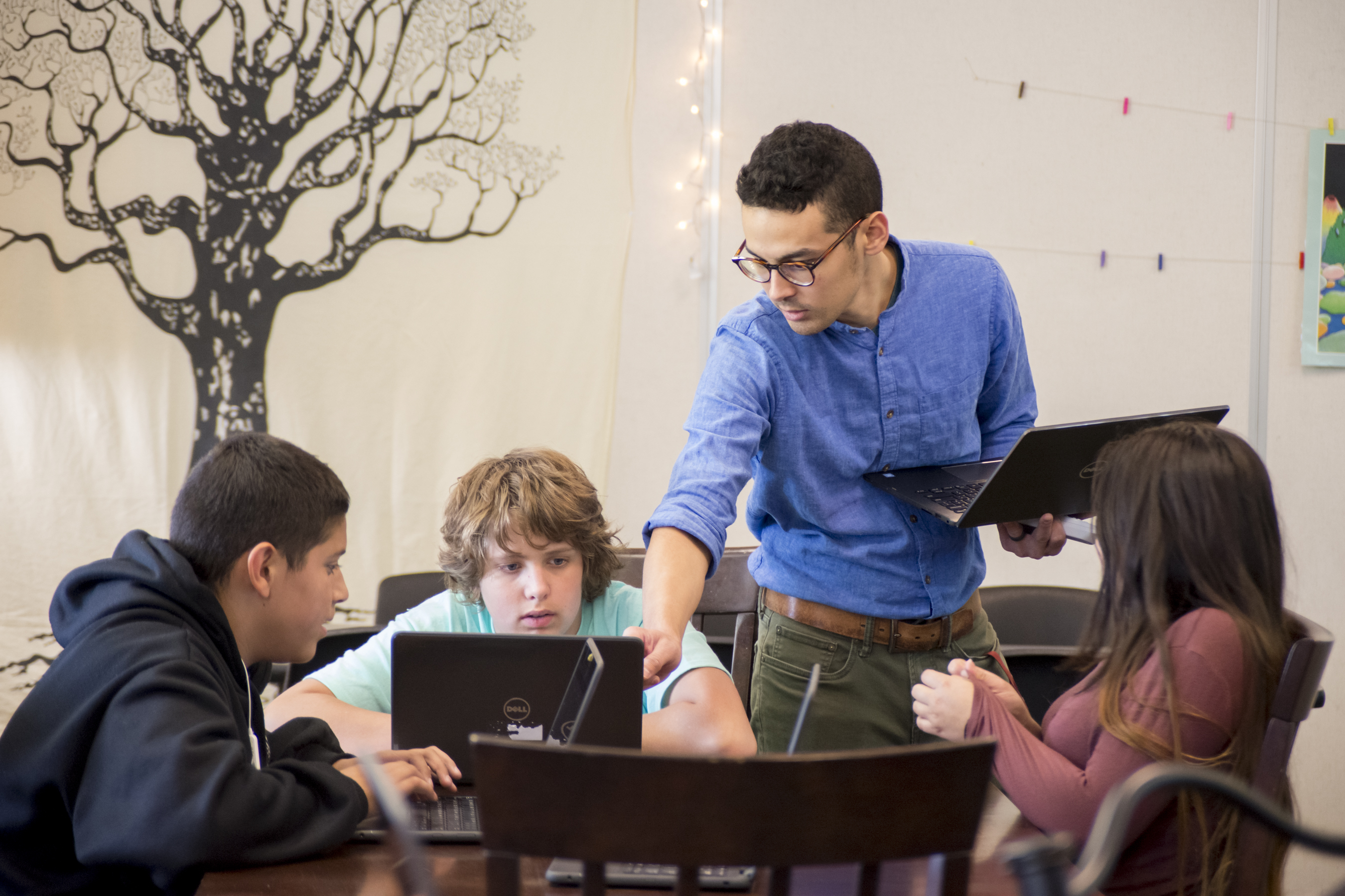 a man teaches students in a classroom