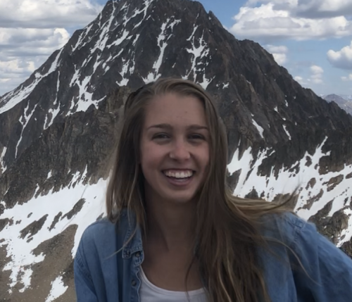 portrait in front of a mountain