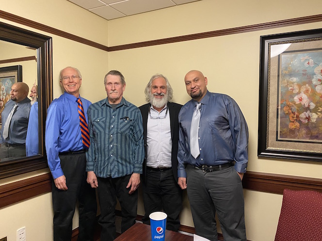Hampikian with attorney and wrongfully convicted men.