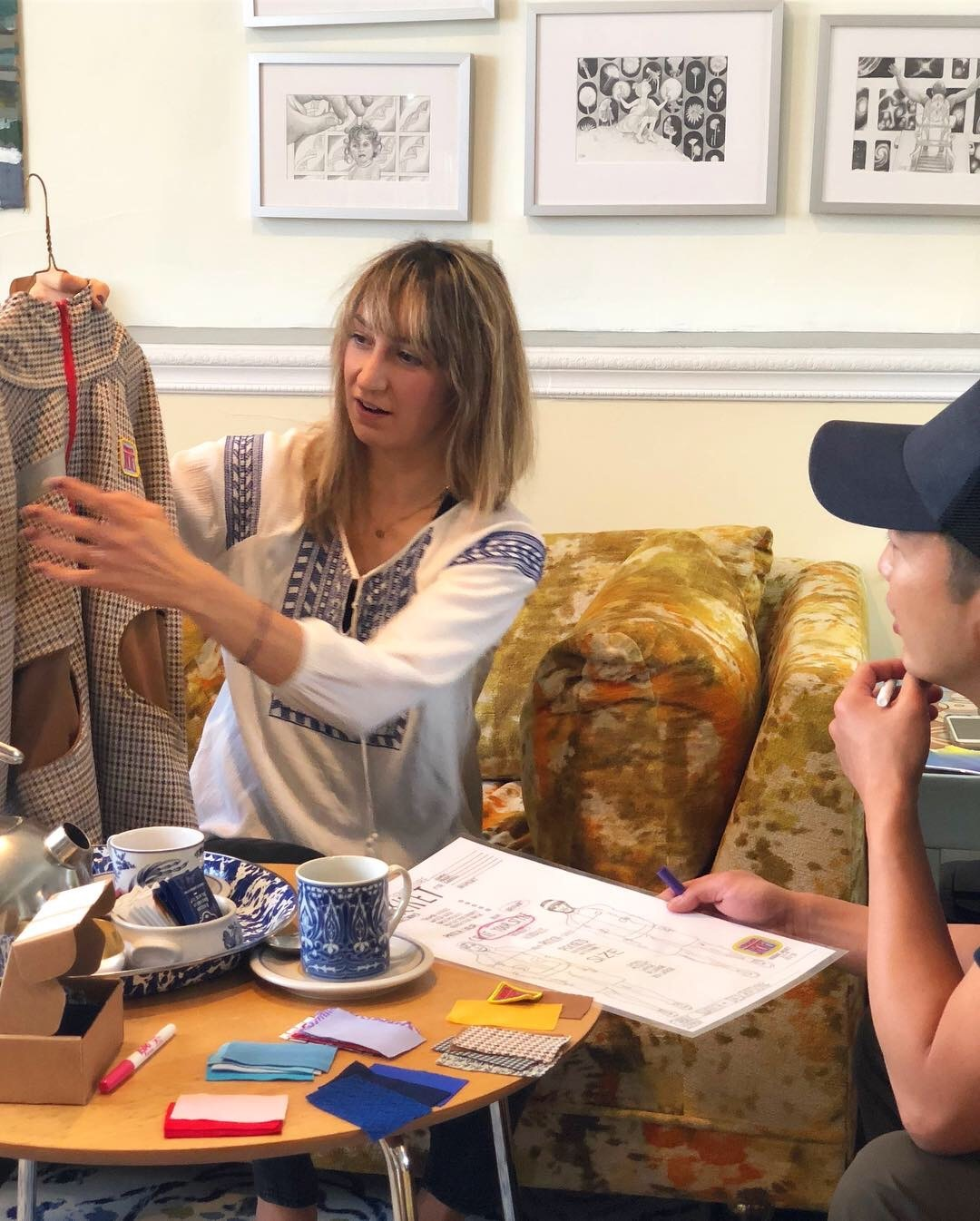 Vander Neut consults with a client to create a custom garment in her home studio