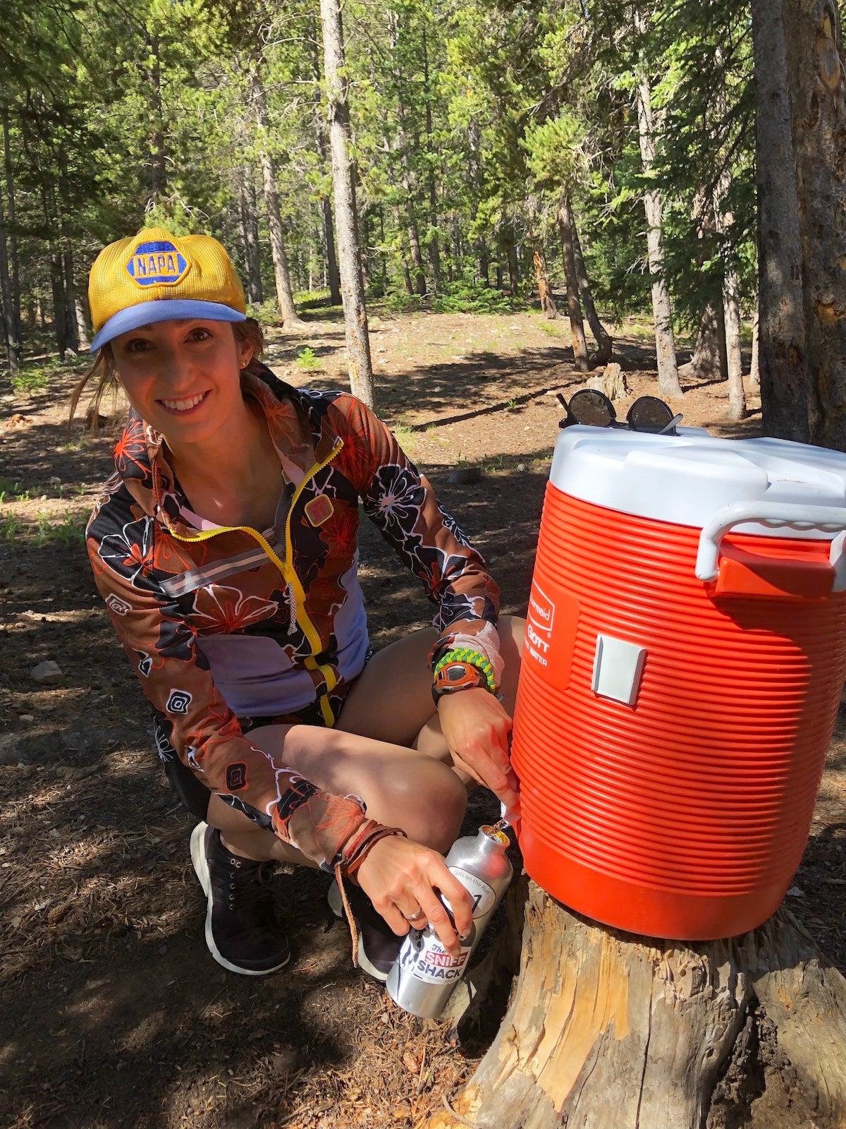 Sarah Vander Neut filling a water bottle