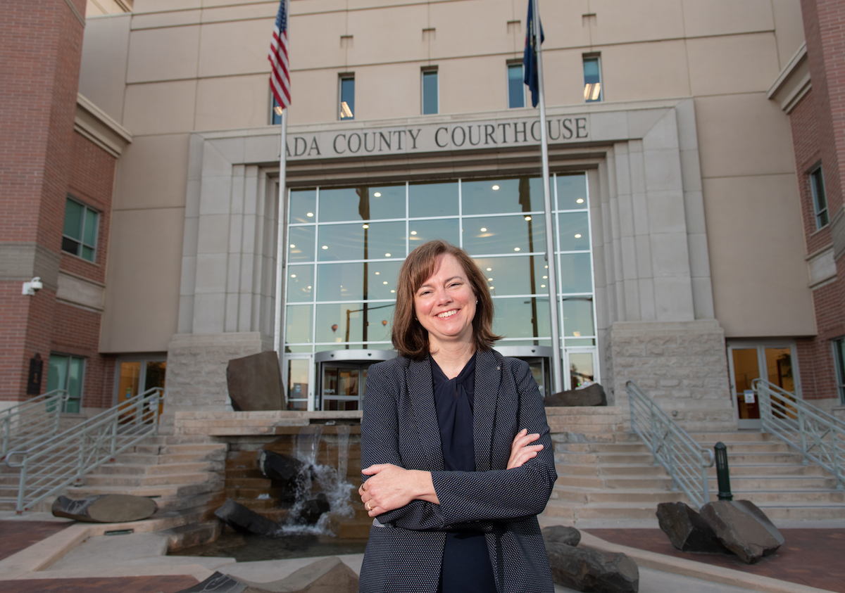Alumna Shawna Dunn in front of the Ada County Courthouse
