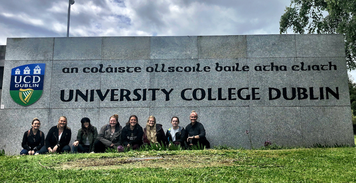 A photo of all 8 students who went to Ireland posing in front of the University College Dublin